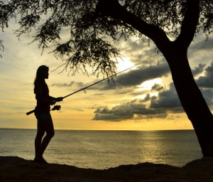 Woman-Fishing-at-Sunset