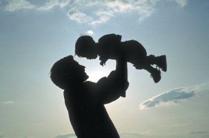 father-lifting-child